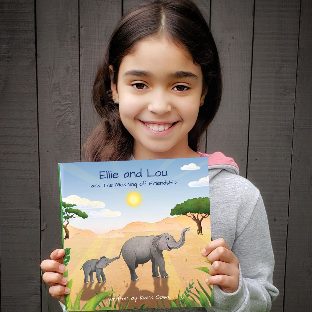 Ellie and Lou Author Holding Book